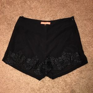 Black dress shorts with lace detailing